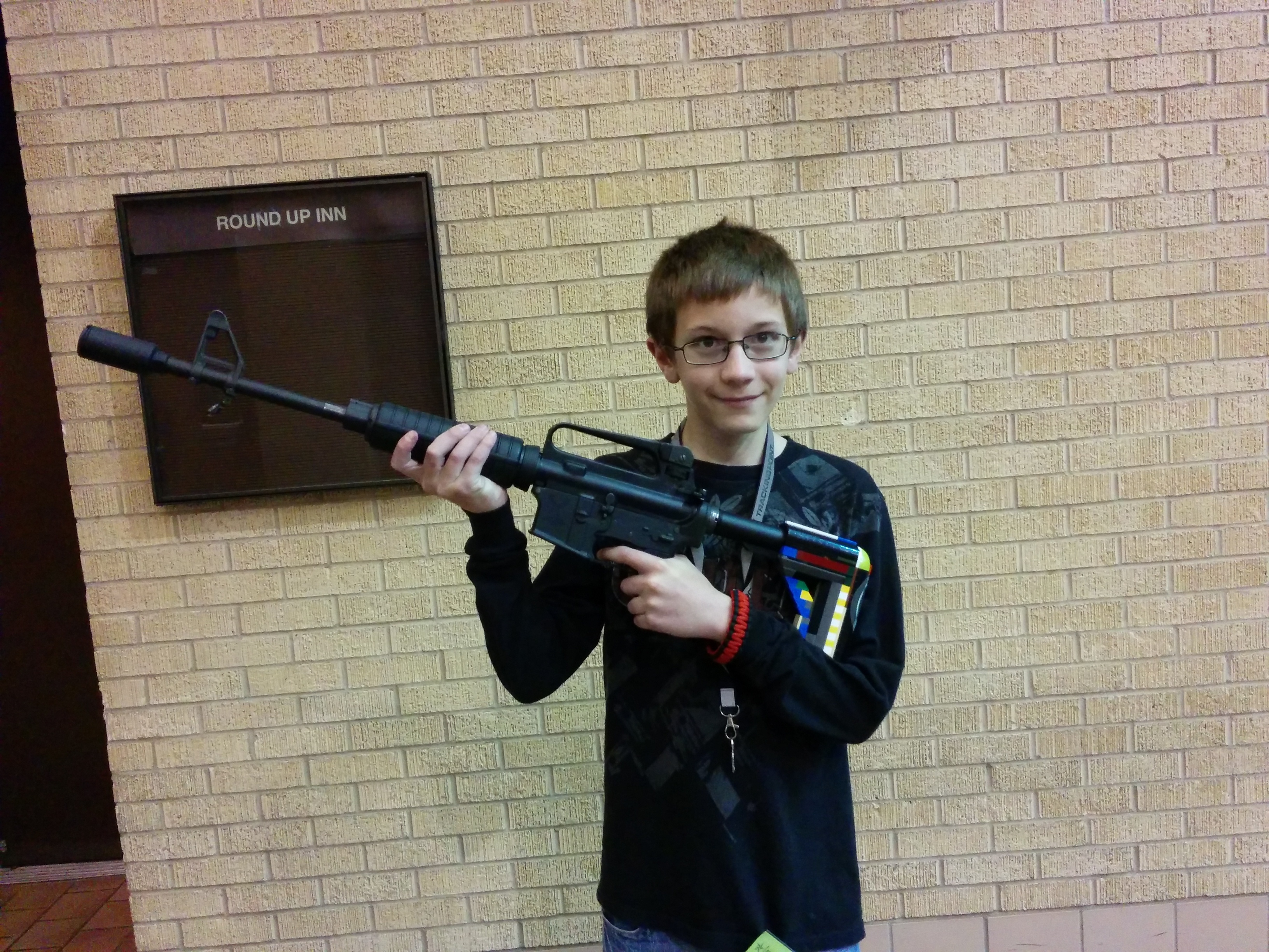 Grayson posing outside the Fort Worth gun show